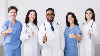 Doctors showing thumbs up and smiling